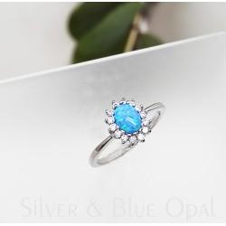 Ezüst gyűrű cirkóniával és kék opállal